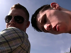 Horny young gay dudes are making out in a parking lot on skid row bereft of a condom!