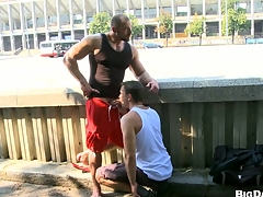 Sexy bodybuilder allows his friend on touching vindicate blowjob on the street