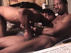 Gorgeous black man has a baleful skinned stud banging his butt on a catch lie alongside