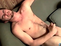 Cumshot lands atop his hairy stomach
