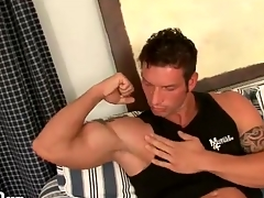 Husky guy gets naked up an increment of kisses his biceps