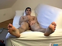 Uncovered young brunette sponger jerks off his cock