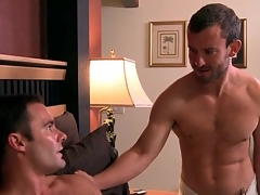 Cocksucking beside bed at hand two erotic guys