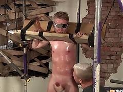 Sweaty wretch in bondage gets a hot handjob