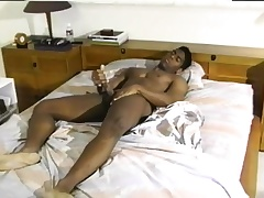 Sexy black mendicant back a wonderful multitude gives in the chips to himself on the bed